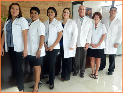 Cosmetic surgeon and staff in Cozumel